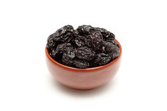Dried prunes in bowl. On white background. Close-up Royalty Free Stock Photography