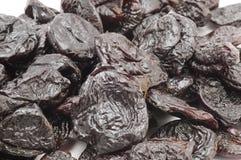 Dried prunes macro stock photo