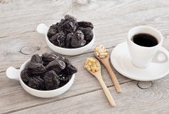 Dried prunes on wood, Pine nut Royalty Free Stock Images