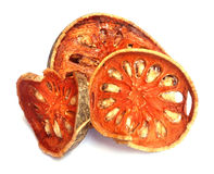 Dried quince slices. On a white background Royalty Free Stock Photo