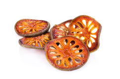 Dried quince slices on a white background.  Royalty Free Stock Photography
