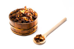 Dried raisins on a wooden bowl Stock Photography