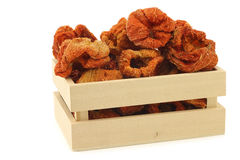 Dried red bell peppers in a wooden box Royalty Free Stock Images