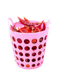 Dried red chili. Isolated dried red chili in pink basket Royalty Free Stock Images