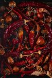 Dried red chili pepper on iron background stock photo