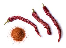 Dried red chili pepper on white background. Desiccated milled paprika. Top view flat lay. stock image