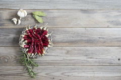 Dried red chili pepper on wooden background Royalty Free Stock Photography