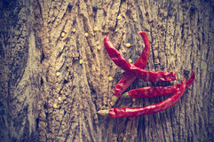 Dried red chili peppers on old wooden background,Vintage color Royalty Free Stock Photos