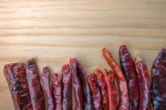 Dried red chili peppers on slate background. Ingredient for thai food on wood table background.  Royalty Free Stock Photo