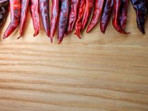 Dried red chili peppers on slate background. Ingredient for thai food on wood table background.  Royalty Free Stock Images