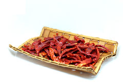 Dried red chilies, hot red pepper in the wood basket isolate on white background Royalty Free Stock Photos