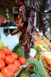 Dried Red chillies in a fruit & vegetable market. A row of dried red chillies on display in a fruit and vegetable market Stock Photography