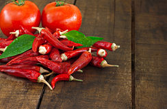 Dried red chillies and tomato Stock Image