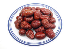 Dried red date. Some dried red date on a plate. In the traditional Chinese medicine, the dried red date has the blood tonic effect stock photos