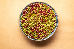 Dried red and green beans mixed in one bowl on wooden background stock photo
