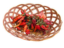 Dried red hot chili peppers in wooden basket Royalty Free Stock Photo