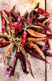 Dried red hot chilli pepper on dark wooden background Royalty Free Stock Photography