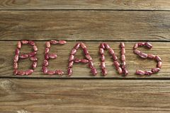 Dried red kidney beans on wooden background stock images