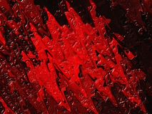 Dried red oil paint on a black background. Abstract stains resembling blood, ketchup or raspberry jam Royalty Free Stock Photos