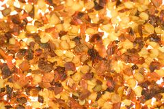 Dried red pepper flakes. A background of dried red pepper flakes stock photos