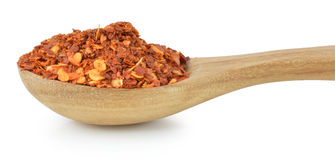Dried red pepper flakes, isolated on white. Royalty Free Stock Photo