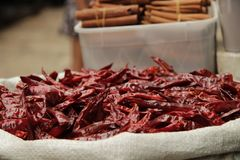 Dried red peppers in white basket stock images