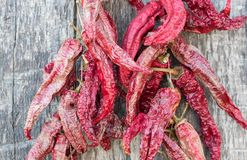 Dried red peppers on a wooden table. Dried red paprika on a old wood table Royalty Free Stock Photo