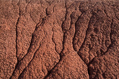 Dried, red sand showing erosion patterns at the Painted Hills in Oregon Stock Photo