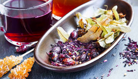 Dried red tea with hibiscus, linden,rosehip fruits and leaves Royalty Free Stock Photos