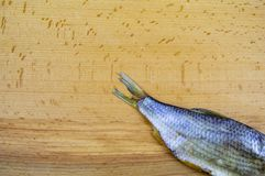 Dried roach fish on a wooden cutting board royalty free stock photos