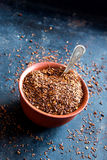 Dried rooibos tea. In ceramic bowl over metal background, natural light Royalty Free Stock Image