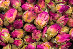 Dried rose buds with magenta pink petals to make aromatic herbal Stock Photo