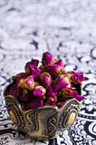 Dried rose buds in a metal Cup Royalty Free Stock Photo