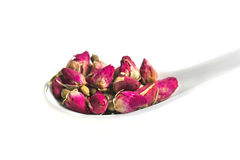 Dried rose buds on spoon Royalty Free Stock Photography