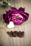 Dried rose and chocolate word YOU Royalty Free Stock Photos