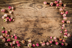 Dried rose flowers on wooden background Royalty Free Stock Photos