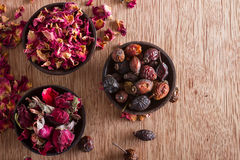 Dried rose hips, buds and petals Stock Photos