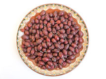 Dried rose hips plate Royalty Free Stock Photo