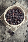Dried rose hips in a wooden bowl Royalty Free Stock Photo