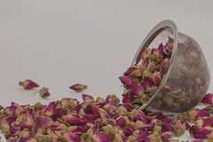 Dried rose petal flower on isolate white background.Blurred close up dried roses flower tea on white background. stock images