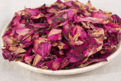 Dried rose petals for natural herbal drink. Royalty Free Stock Photos