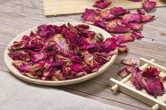 Dried rose petals for natural herbal drink. Royalty Free Stock Image