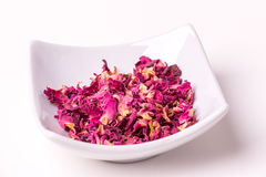 Dried rose petals. On a white background, studio isolated Royalty Free Stock Image