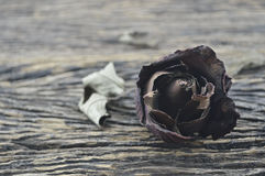 Dried Rose on wooden background, broken heart concept Stock Photo