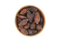 Dried rosehip berries in a wooden bowl Royalty Free Stock Images