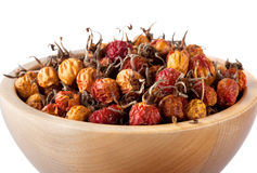 Dried rosehips in wooden bowl Royalty Free Stock Photos