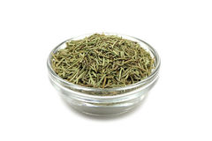 Dried rosemary in a glass cup Stock Photo