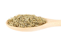 Dried rosemary in wooden spoon  on white background Stock Photo