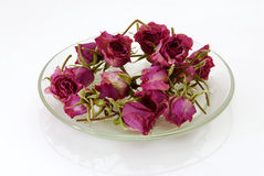 Dried Roses. Glass plate with dried pink Roses Royalty Free Stock Photo