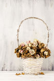 Dried roses in basket Royalty Free Stock Image